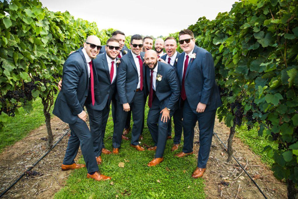 groom and groomsmen in vineyards