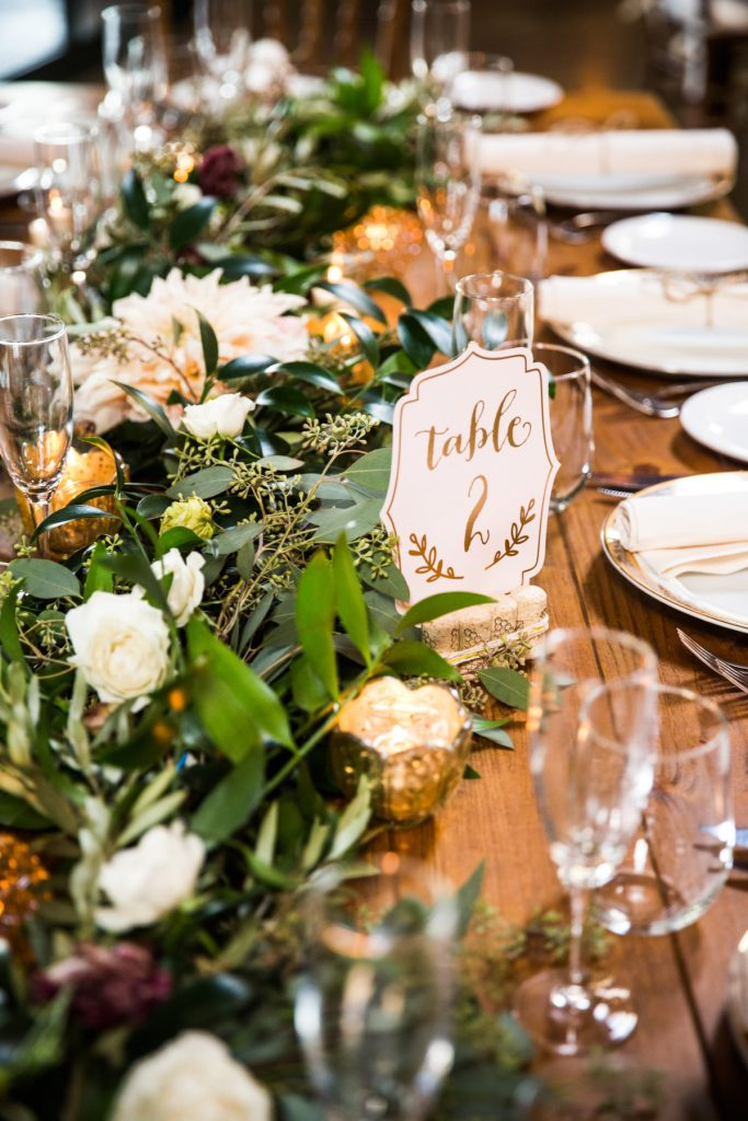 greenery table runner with white roses
