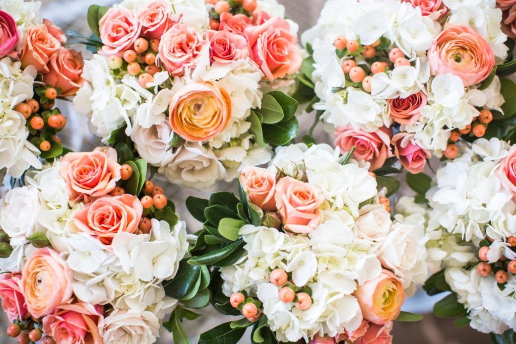 coral white and greenery bridesmaids bouquets by Blooming Blossoms