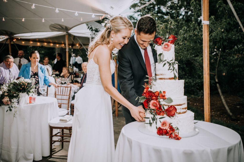 Sasha and Michael | Bride and groom cutting wedding cake