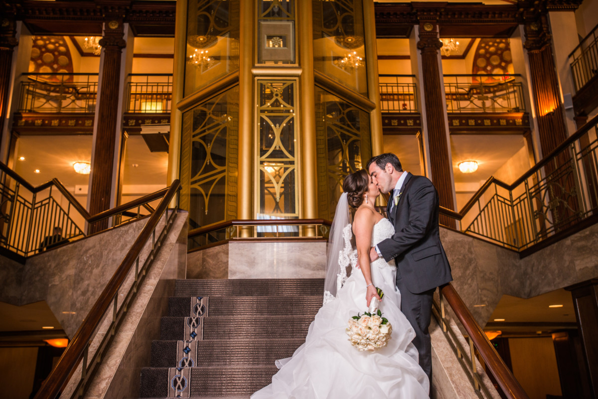 Lauren and Jimmy   Wedding at the Providence Biltmore   Bride and groom on grand staircase