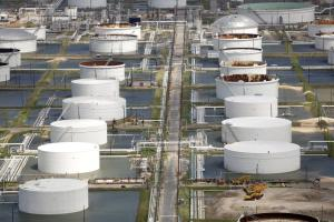 Oil refinery storage tanks in Texas City surrounded by rainwater from Hurricane Harvey