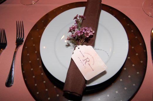 Each place setting was hand wrapped with the couples monogram and thank you note, with a sprig of wax flower.