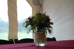 Burlap wrapped mason jars with seeded euch, green hydrangea, alstromeria, and curly willow.