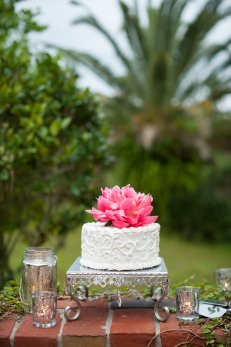 One stunning coral charm peony is all this little cake needs to shine!