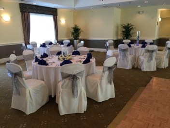tall and short centerpieces in white and royal blue