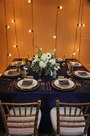 Starry night table scape with white hydrangea, tulips, anemones and eucalyptus