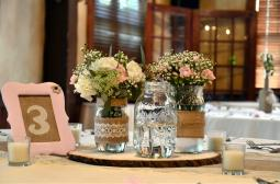 Empty mason jars await their floral from the wedding ceremony