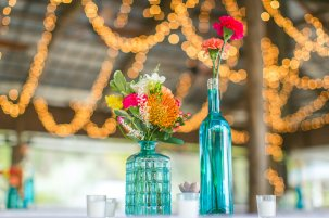 Blue glass with bright stems of floral