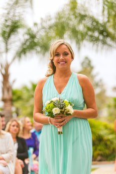 Bridesmaid with bouquet in mint and white