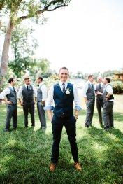 Handsome groom in navy vest