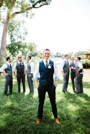 Handsome groom in navy vest
