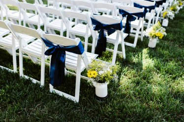 Aisle markers of wild flowers in yellow and white