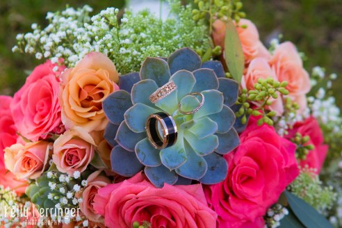 Bridal bouquet with rings (Succulents, seeded eucalyptus, peach spray roses, Queens Ann lace, babies breath, and Amsterdam standard roses)