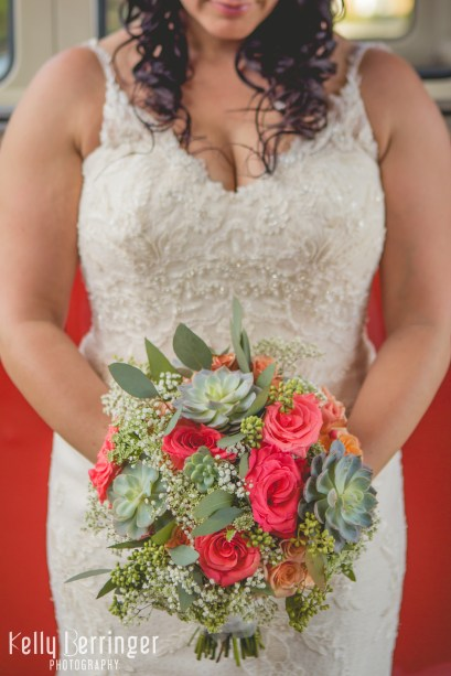 Bridal bouquet with succulents, seeded eucalyptus, peach spray roses, and Amsterdam standard roses