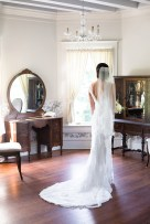 Bride getting ready with stunning gown and veil - Bluegrass Chic Floral