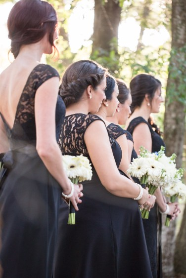 Outdoor wedding ceremony, bridesmaids in classic black with white and black bouquets - Bluegrass Chic Floral