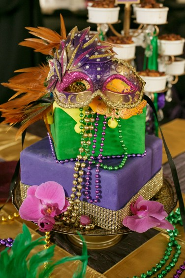 Mardi Gras cake by Two Sweets Bake Shop with a few orchids to compliment