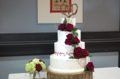 Handmade cake topper by Bluegrass Chic with cascading red roses and greens