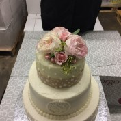 Beautiful white and blush garden roses with seeded eucalyptus