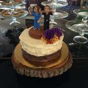 Cute cake topper with a little floral that matched the bouquet