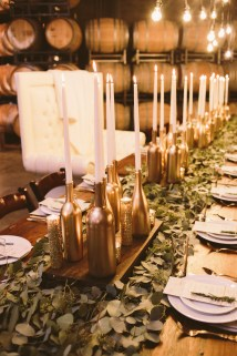 Lavish greens with gold bottles and candles