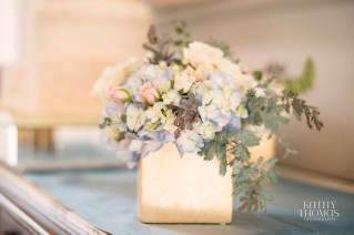 Elegant gold cube with blue hydra, eucalyptus, white hydrangea, blush spray rose and acacia