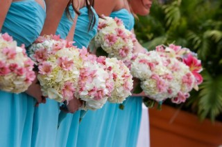 Our Maids' white Hydrangea bouquets with pops of pink Alstroemeria, paired with their gorgeous light blue gowns.