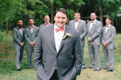 Our groom, Michael, and his groomsmen. Michael's boutonniere is designed inside a shotgun shell with blush spray roses and blush astilbe.