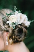 Samantha's hair piece filled with blush ranunculus, baby blue eucalyptus, and white alstroemeria.