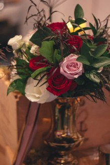 Bridal bouquet of red freedom roses, white tibet roses, ester roses, Israeli ruscus and brown agnus.