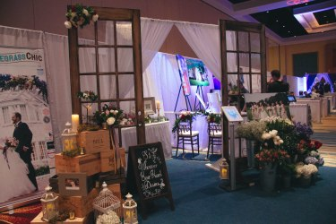 Wedding expo booth with a french market and rustic garden theme.