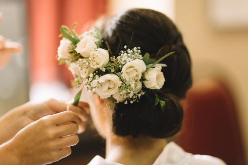 Floral comb of ivory spray roses, babies breath and eucalyptus.