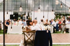 Edison bulb canopy as a backdrop for the sweetheart table.