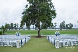 Adding a pop of color down the aisle, hydrangea and blue stock break up the all white pattern