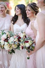 Maids in blush and bride in ivory with ivory, blush and burgundy bouquets.