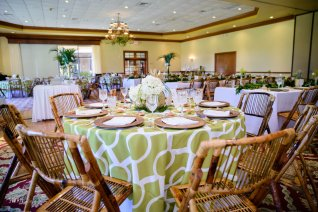 Room set with multiple styles of centerpieces for variety of height and design.