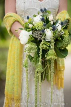 Bridal bouquet created with thistle, brunia, green hydrangea, queens anne lace, garden roses, spray roses, bupleurum, amarathus, and hypericum berries.