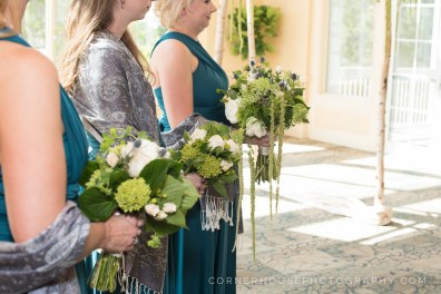 Bridemaids bouquets made with thistle, garden roses, bupleurum, and green hydrangea.