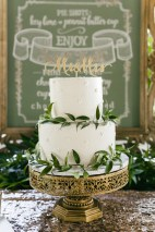 Simple greens and a cake topper finish this beautiful can off