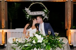 Sweetheart table with greens and hanging chalk art