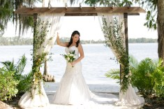 Ceremony arch with greenery and a touch of gold