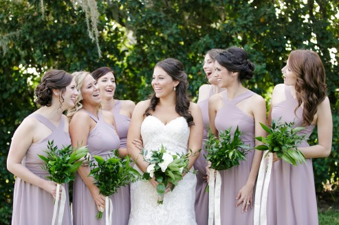 Bride with her maids carrying all greens bouquets with trailing ribbons