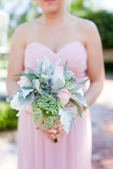 Brides maids bouquet with dusty miller, roses, queens anne lace, and eucalyptus.