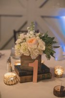 Centerpieces with white hydrangea, ranunculus, garden roses, spray roses, and eucalyptus.