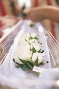 Groomsmen boutonniere with cream spray roses