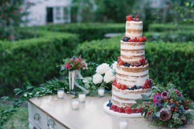 Naked cake with fresh fruit and flowers