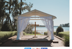 Lake backdrop with soft drapes and a ceremonial cross