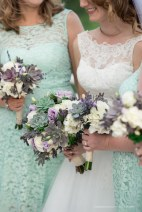 Soft and edgy with succulents, lavender, rosemary, white and lavender roses with eucalyptus and acacia greenery