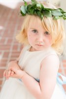 Floral halo of greens for the flower girl.